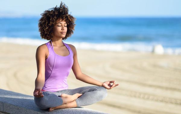 Practicing meditation and deep breathing